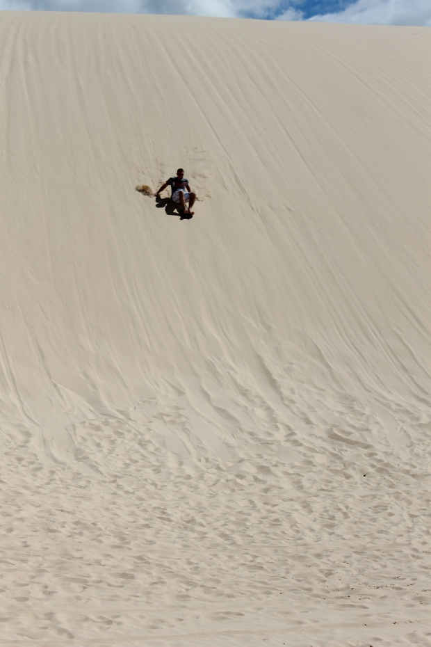 Sandboarding at Birubi Beach