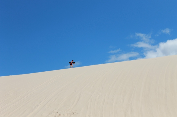 Climbing up the hill to sandboard